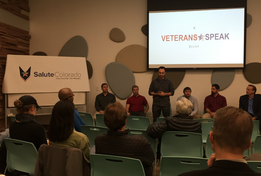 Origins Training Group founders Brian and Matt sharing stories on stage at a Veterans Speak event in Colorado.